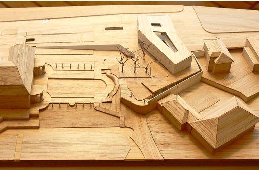 Das Ensemble im Holzmodell: Oben in der Mitte  das neue Erweiterungsgebäude, links daneben schließen sich unterirdische Gebäudeteile an, die Villa ist am linken Bildrand erkennbar. Foto: