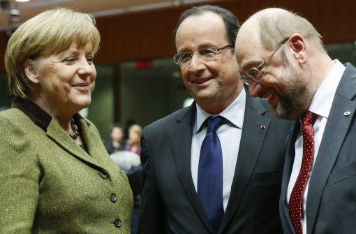 Bundeskanzlerin Angela Merkel, Frankreichs Staatspräsident Francois Hollande und Europaparlamentspräsident Martin Schulz (rechts) auf dem Gipfel in Brüssel. Foto: dpa