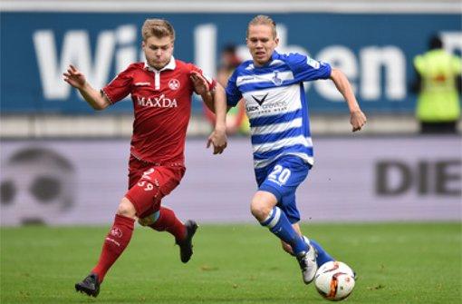 Jean Zimmer (links) vom 1. FC Kaiserslautern ist in den Fokus des VfB Stuttgart geraten.  Foto: dpa