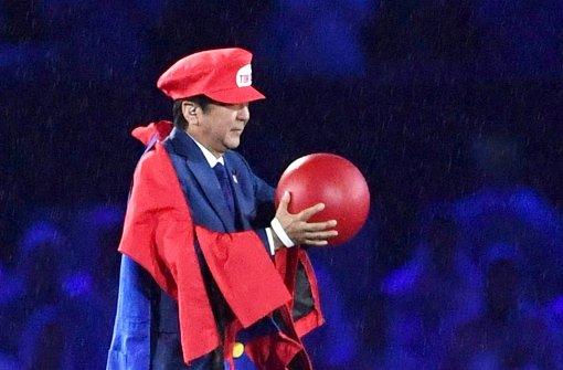 """Japans Premier taucht als """"Super Mario"""" auf"""