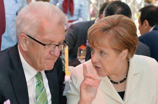 Flirten Kretschmann und Merkel?
