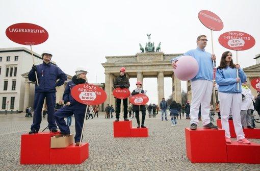 In vielen Städten gibt es anlässlich des Equal Pay Day Aktionen – so wie hier in Berlin. Foto: dpa